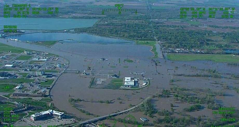 FILE — Portions of Poseyville Road and the Dow Michigan Operations Industrial Park are seen under water in a screenshot of a Michigan State Police video in Midland in May. Photo: Michigan State Police/Courtesy Photos