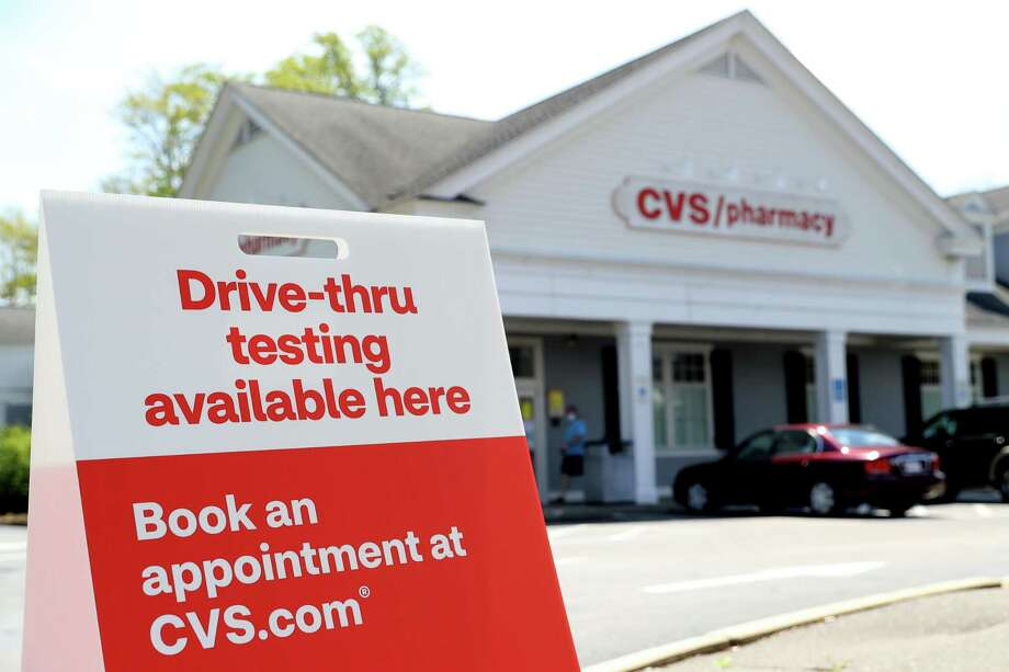 BRIDGEWATER, MASSACHUSETTS - MAY 15: A sign promoting drive-thru coronavirus (COVID-19) tests at CVS Pharmacy on May 15, 2020 in Bridgewater, Massachusetts. Nine CVS locations began providing coronavirus tests in Massachusetts, issuing self swab tests to people by appointment. (Photo by Maddie Meyer/Getty Images) Photo: Maddie Meyer / Getty Images / 2020 Getty Images