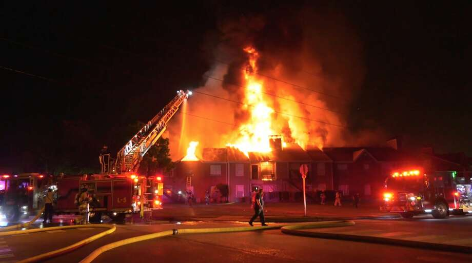 Tomball firefighters battle a massive apartment fire at 920 Lawrence Street on Thursday, May 21, 2020. Photo: OnScene.TV