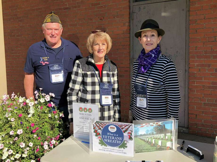 Allan Bixler collecting for Wreaths Across America with Karen Polett and Carol Wilder-Tamme last fall. Normally, the committee in Darien collects donations at retail stores, but this was determined to be unsafe during the COVID-19 pandemic. The committee is seeking help with donations. Photo: Contributed Photo / / Connecticut Post