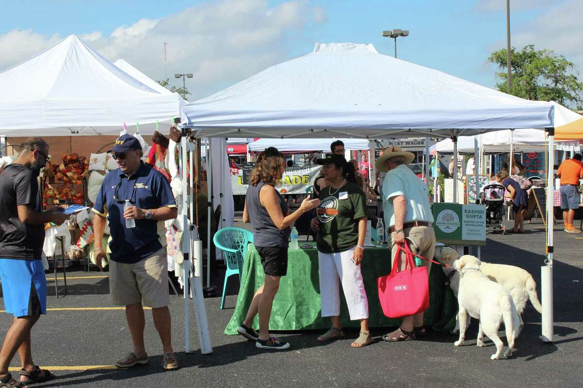 On Saturday, Sept. 19, local residents and voters in The Woodlands will be able to 'meet and greet' six candidate for four seats on the township Board of Directors at a voter awareness booth at The Woodlands Farmers Market. The six candidates who have confirmed their attendance as of Sept. 16 are: for the Position 4 seat, Dan Hannon; the lone candidate for the Position 3 seat, John Anthony Brown; Position 2 seat candidate Jimmie Dotson; and then all three candidates for the Position 1 seat: incumbent Gordy Bunch and challengers Dr. Jerry Smith and Ron Keichline. In this file photograph from 2019, candidates Walter Lisiewski, Rashmi Gupta and other residents chat at the booth.