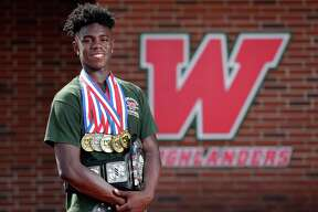 KeSean Carter was a three-sport standout at The Woodlands, competing in football, basketball and track and field.