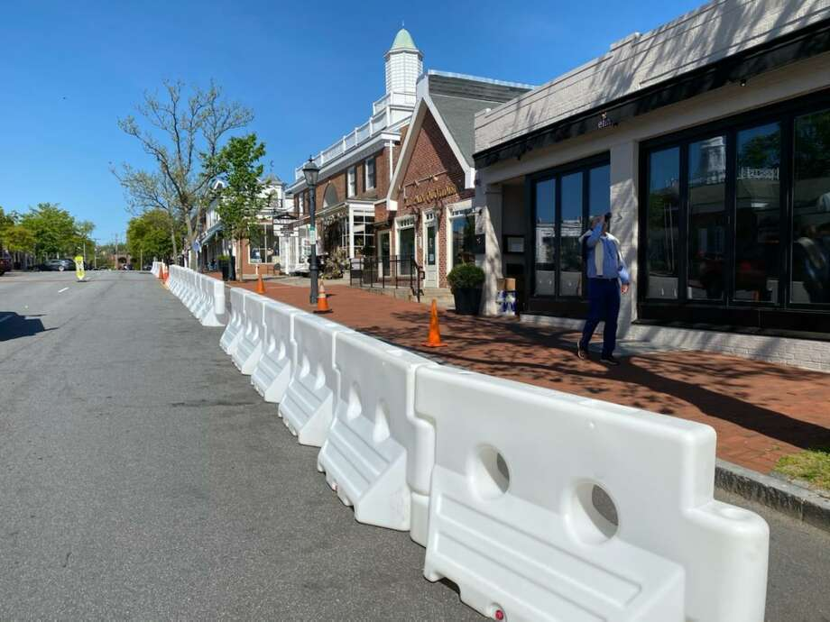 Plastic barriers have arrived on Elm Street in New Canaan. After concern that they would not arrive in time for the restaurants in the town to serve people for outdoor dining by Friday, May 22, when the town is gearing up to do so following Connecticut Gov. Ned Lamont re-opening of the state's economy on Wednesday, May 20, the barriers are being set up after arriving on Thursday, May 21. Photo: Grace Duffield / Hearst Connecticut Media