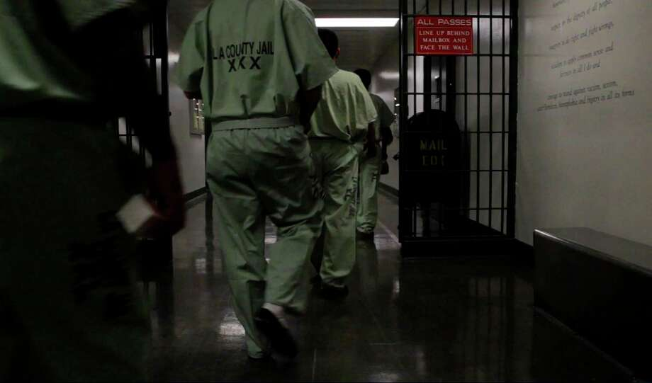 Inmates walk in a tight line to their cell blocks at the L.A. County Jail in 2013 (Gina Ferazzi/Los Angeles Times/TNS) Photo: Gina Ferazzi / Gina Ferazzi/TNS / Los Angeles Times