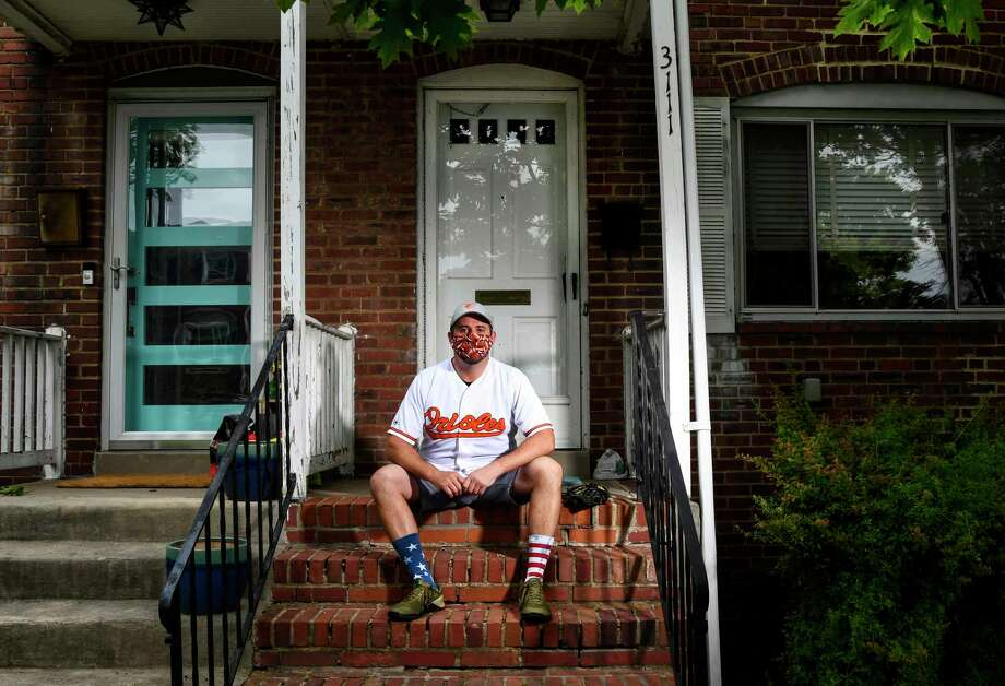 Gary Politzer, a lifelong Orioles fan who is missing going to games and watching his team on television, poses for a photograph outside of his home. Photo: Washington Post Photo By Toni L. Sandys. / The Washington Post