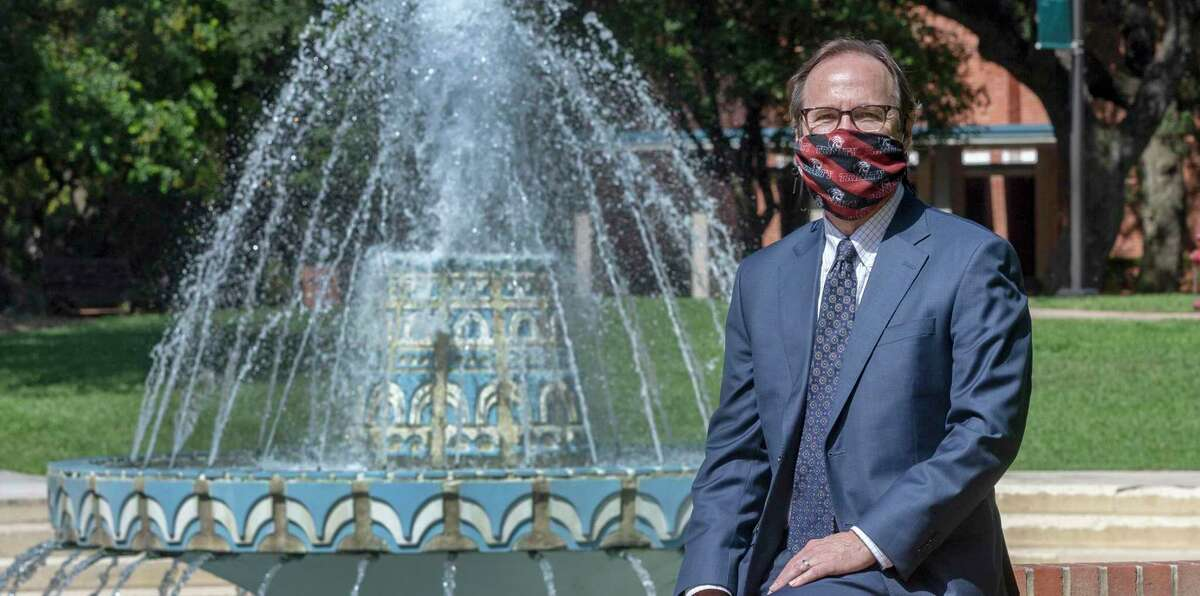 Danny Anderson, Trinity University president, poses Wednesday in front of Miller Fountain on the university's campus.