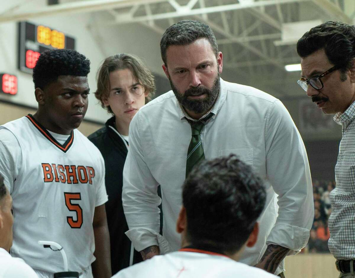 This image released by Warner Bros. Pictures shows Charles Lott Jr., left, Ben Affleck and Al Madrigal in a scene from