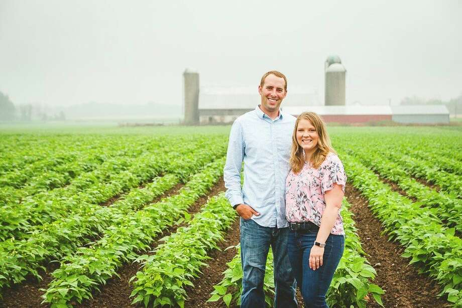 Kevin Messing with his wife Sarah in the fields of Sheridan Farms. (Courtesy Photo)