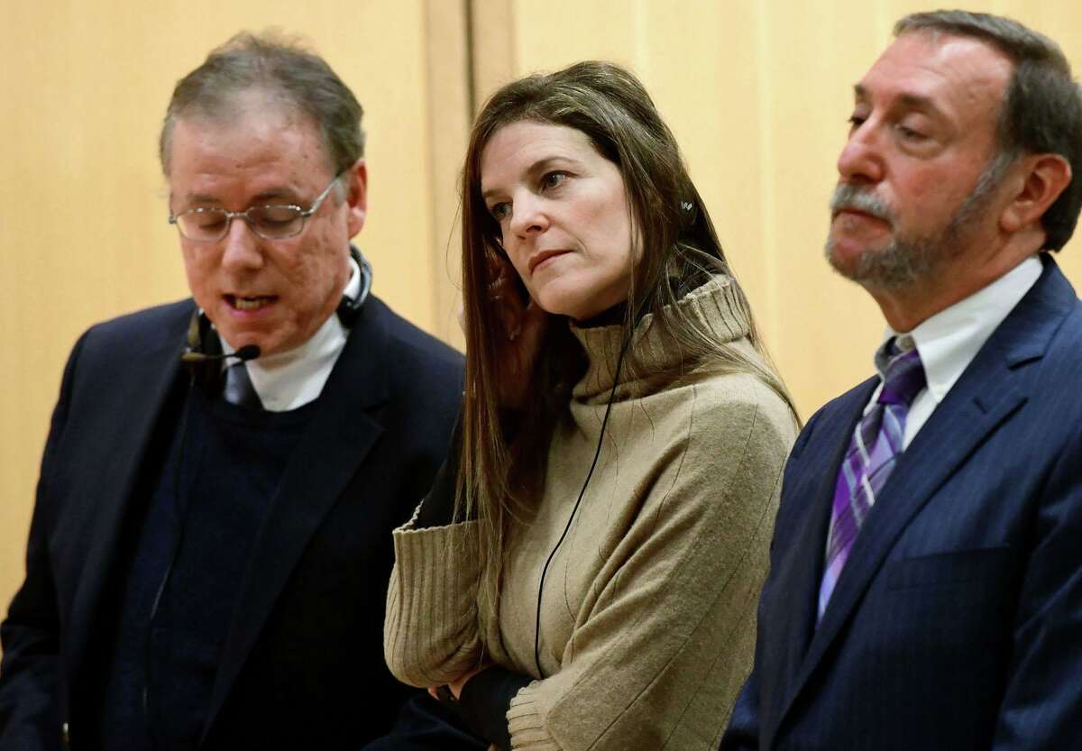 Michelle Troconis, charged with conspiracy to commit murder in the disappearance of Jennifer Dulos, appears for a pre-trial hearing with an spanish interpreter and her attorney Jon L. Schoenhorn on Friday, February 6, 2020, at the Stamford Superior Court in Stamford, Conn.
