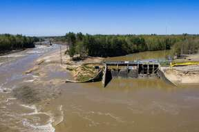 An aerial photo taken Thursday, May 21, 2020 shows the aftermath of record flooding following the breach of the Edenville Dam and failure of the Sanford Dam in Midland County. The Tittabwassee River reached a record 35.05 feet in Midland on Wednesday, May 20.