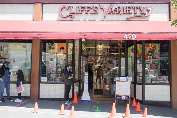 Customers wait in line social distancing at Cliff?•s Variety store on Castro Street in San Francisco on May 20, 2020.