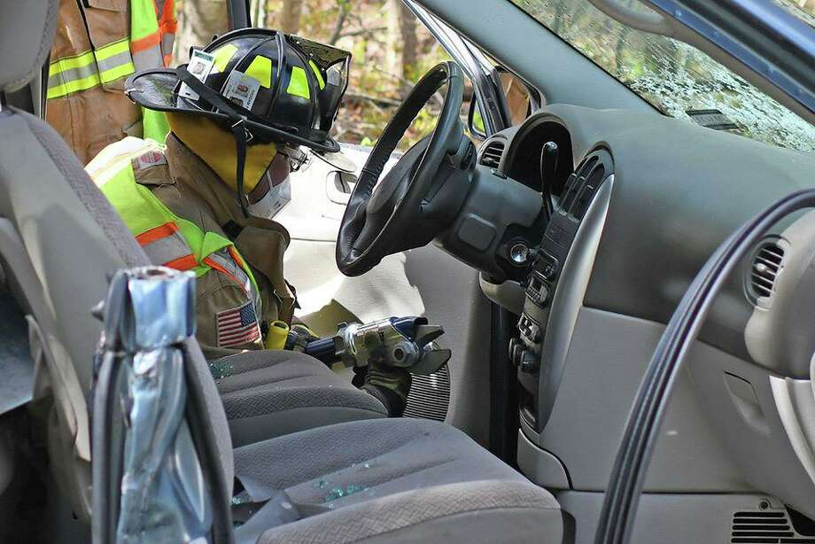 Members of the Haddam Volunteer Fire Co. take part in extrication tools training. Photo: Olivia Drake Photo