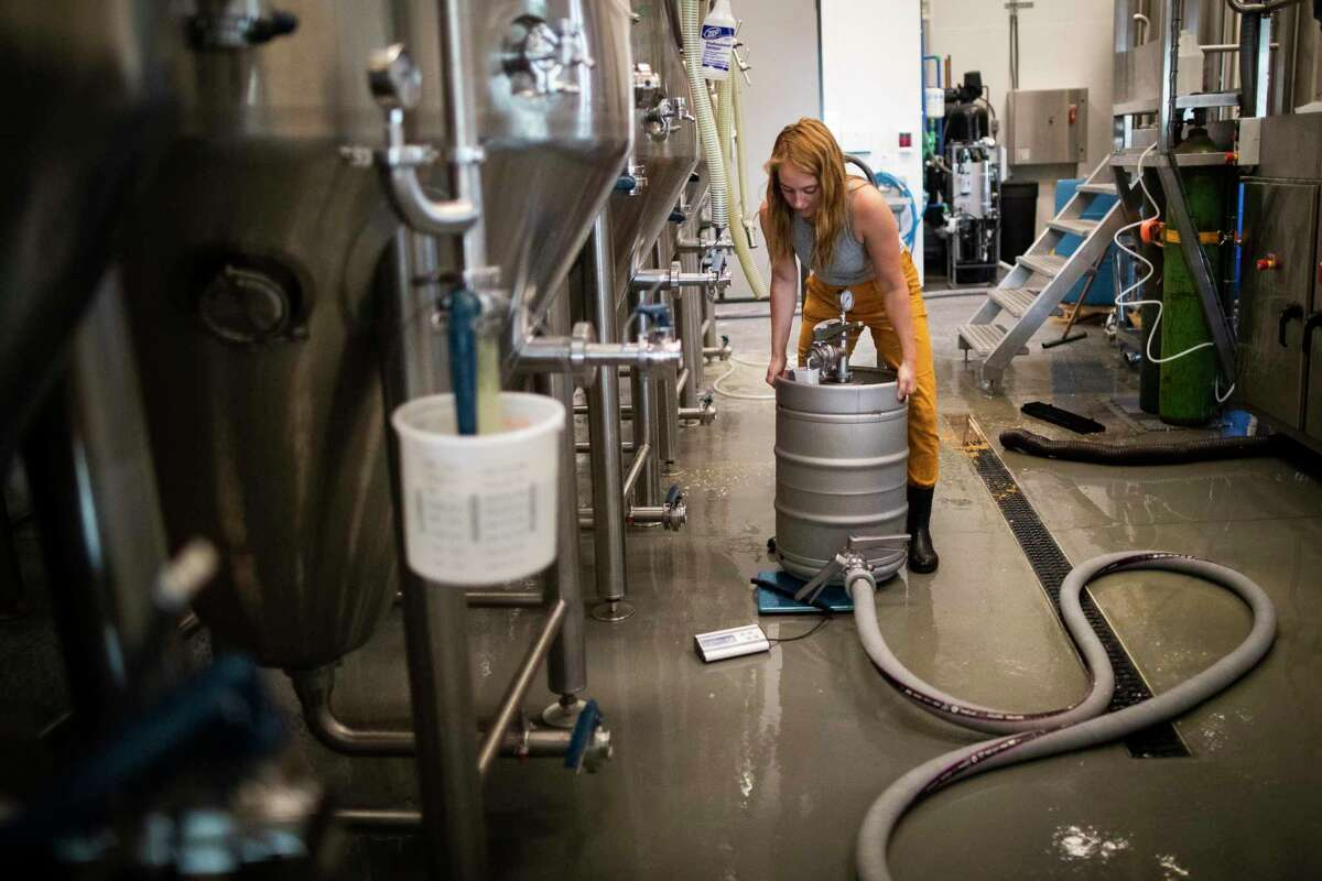 Urban South Brewery - HTX brewer Angela Gabelman works in the production room of the brewery on Wednesday, May 20, 2020, in Houston.