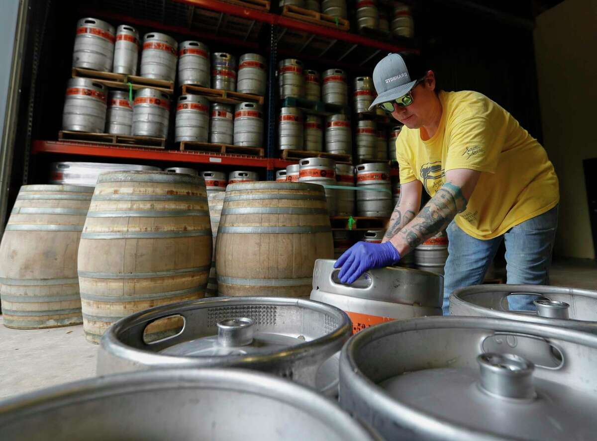 Bill Ferguson rolls a keg freshly filled with beer at B-52 Brewing ahead of Friday's reopening Wednesday, April 20, 2020, in Conroe. The brewery reopens to customers Friday with social distancing and other guidelines under Gov. Greg Abbott's phased reopening of the economy.