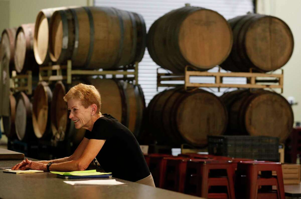 B-52 Brewing Co-owner Pam Daniels shares a laugh as she meets with employees to prepare for the brewery's Friday reopening, Wednesday, April 20, 2020, in Conroe. The Brewery reopens to customers Friday with social distancing and other guidelines under Gov. Greg Abbott's phased reopening of the economy.