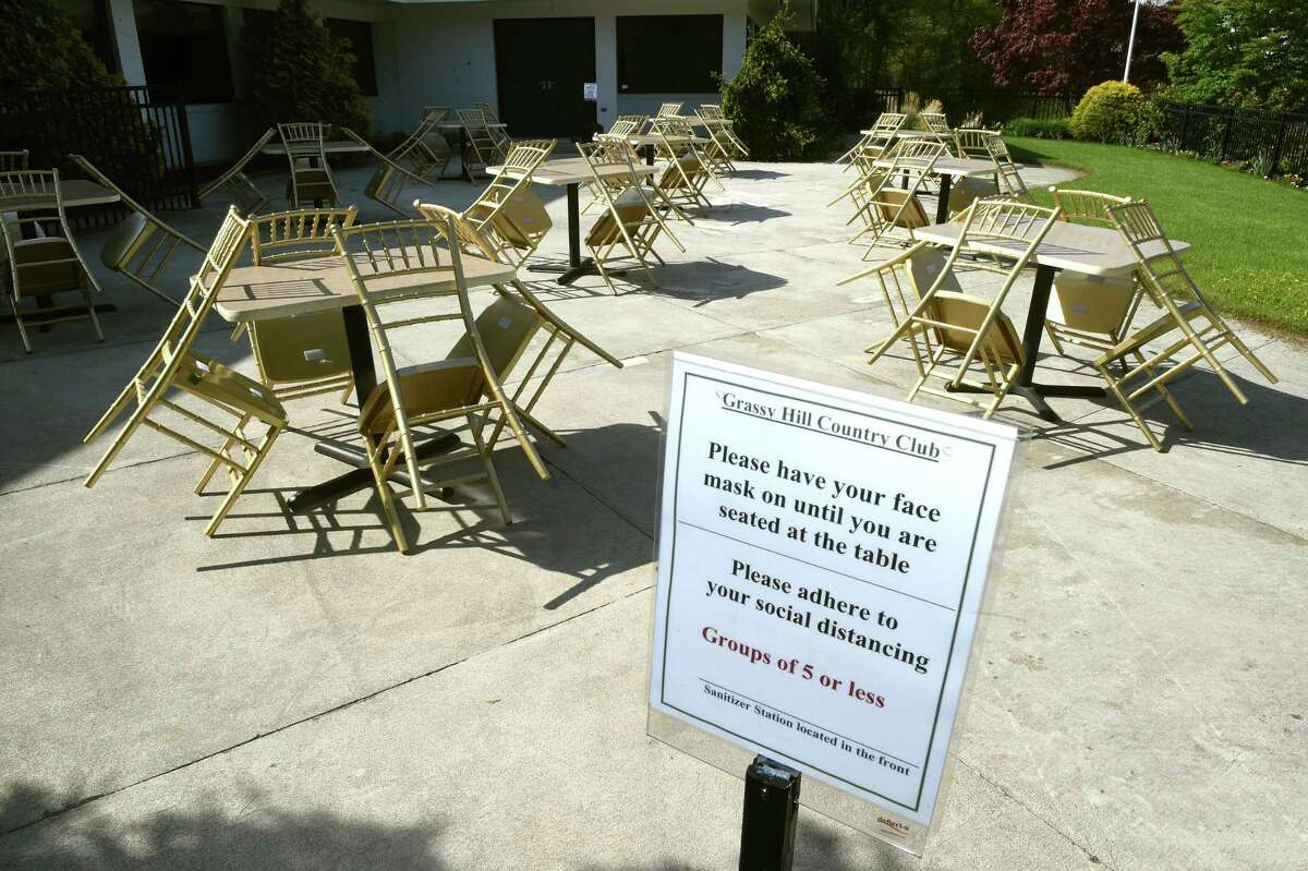 A dining area set up at the Grassy Hill Country Club in Orange on May 20, 2020.