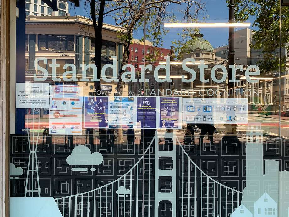 Social-distancing signs and other protocols are posted at Standard Cognition's cashier-less grocery store on Market Street in San Francisco. Photo: Standard Cognition