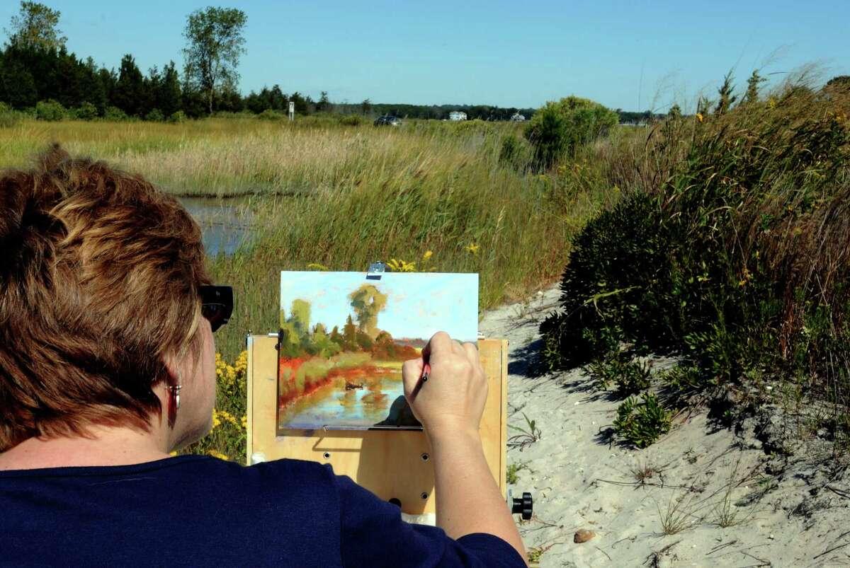 A artist recreates the view at Hammonassett Beach State Park in Madison.