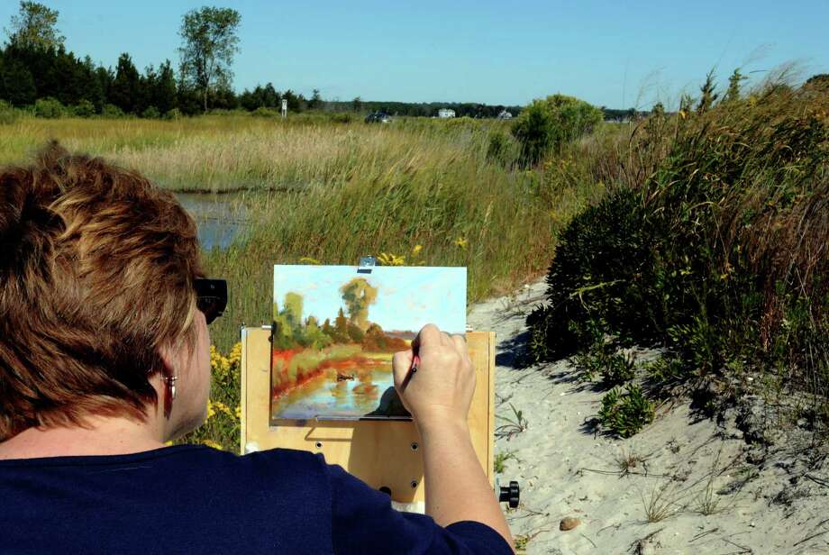 A artist recreates the view at Hammonassett Beach State Park in Madison. Photo: Mara Lavitt / Hearst Connecticut Media