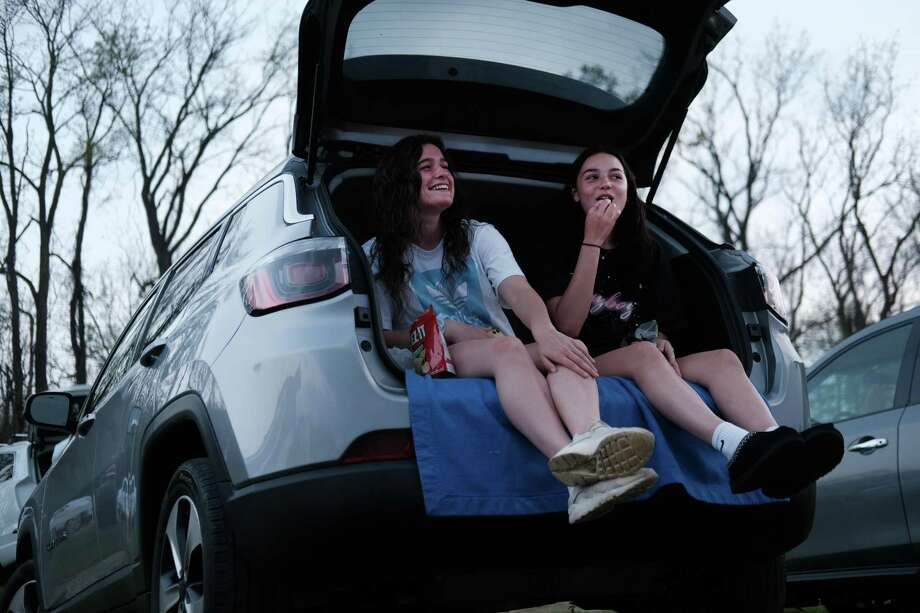 Teens enjoy some snacks from the back of a car. (Photo by Spencer Platt/Getty Images) Photo: Spencer Platt / Getty Images / 2020 Getty Images
