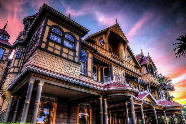 The Winchester Mystery House at sunset.
