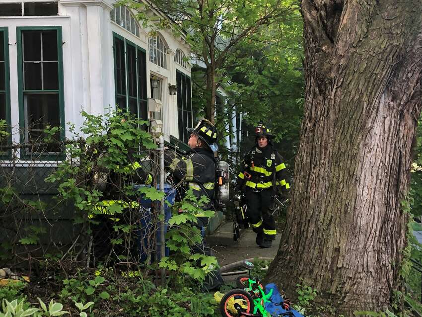 Albany City firefighters battle a house fire at 271 West Lawrence Ave. in Albany's Pine Hills neighborhood Thursday morning, May 21, 2020. (Gary Hahn / Times Union)