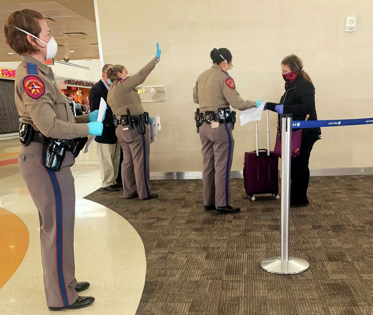 A team of Texas State Troopers greeted passengers leaving a United flight from Chicago at San Antonio International Airport. Travelers were required to fill out a quarantine form disclosing where they will shelter in place for the next 14 days. An executive order by Gov. Greg Abbott required travelers boarding planes in Chicago and other designations to quarantine once they arrive in Texas.
