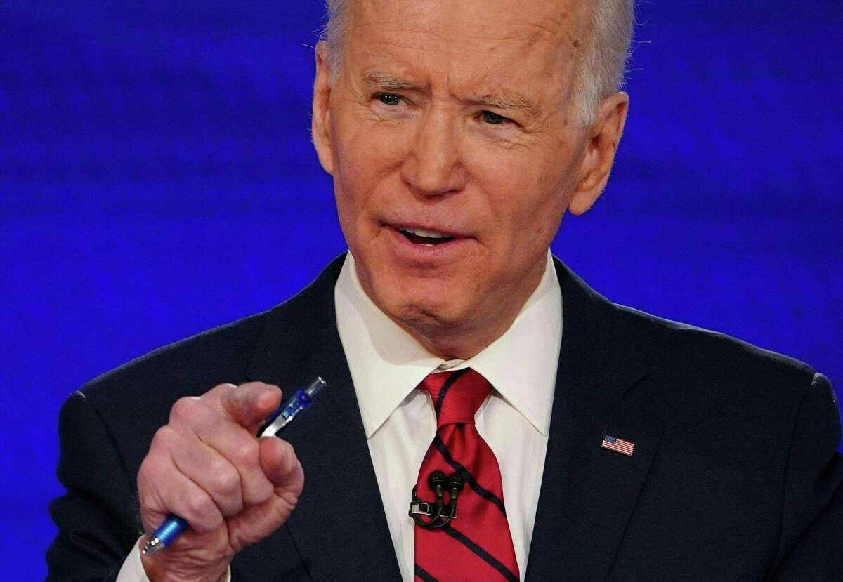 """(FILES) In this file photo Democratic presidential hopeful former US vice president Joe Biden takes part in the 11th Democratic Party 2020 presidential debate in a CNN Washington Bureau studio in Washington, DC on March 15, 2020. - Joe Biden won the endorsement for US president April 27, 2020 of Nancy Pelosi, who hailed him as a """"voice of reason"""" capable of leading America out of the coronavirus crisis.Pelosi was the last leading Democrat to endorse formally Biden's run for the White House against Republican Donald Trump in November.""""Today I am proud to endorse Joe Biden for president of the United States because he will be an extraordinary president,"""" the speaker of the House of Representatives said in the pre-recorded message. (Photo by Mandel NGAN / AFP) (Photo by MANDEL NGAN/AFP via Getty Images)"""
