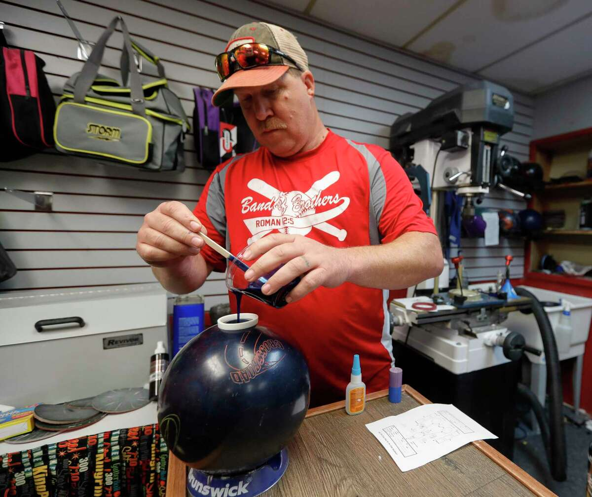 Pro shop manager Kenny King fills a plug for a customer's bowling ball at 300 Bowl, Thursday, May 21, 2020, in Conroe. Owner Dallas Kingery was able to keep staff working after receiving a loan under from the Small Business Administration through the paycheck protection program. The business reopens to customers Friday with social distancing and other guidelines under Gov. Greg Abbott's phased reopening of the economy.