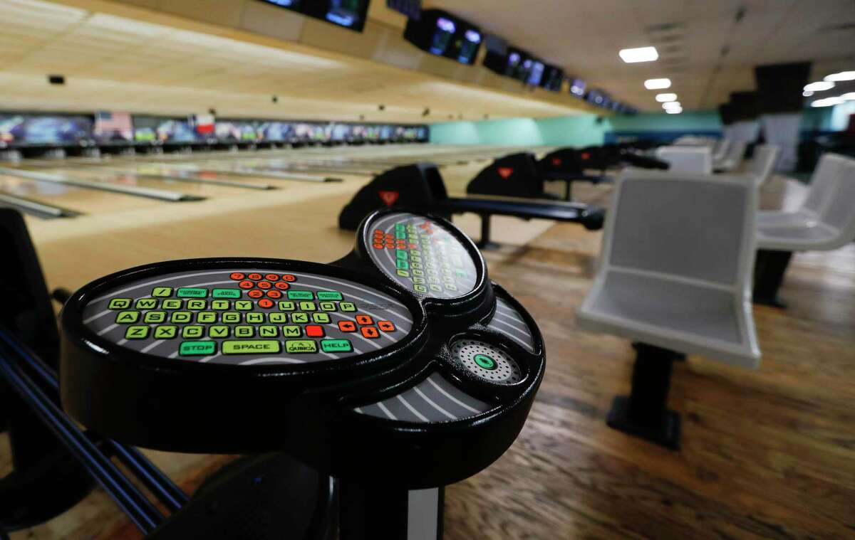 Control panners will we wiped down after every customer finishes a game of bowling at 300 Bowl, Thursday, May 21, 2020, in Conroe. The business reopens to customers Friday with social distancing and other guidelines under Gov. Greg Abbott's phased reopening of the economy.