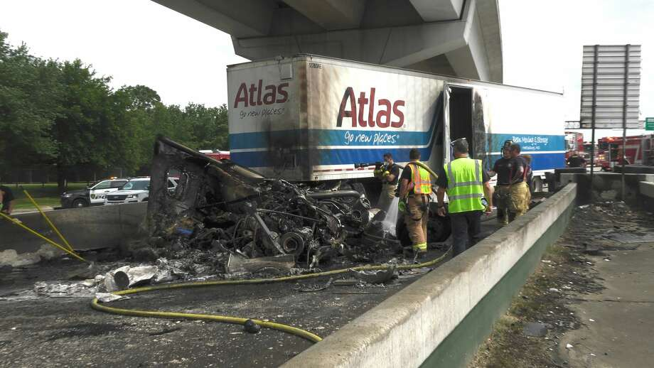 Houston and Little York firefighters tap out a large big rig fire along the North Freeway near Greens Road on Thursday, May 21, 2020. Photo: Jay R. Jordan / Houston Chronicle