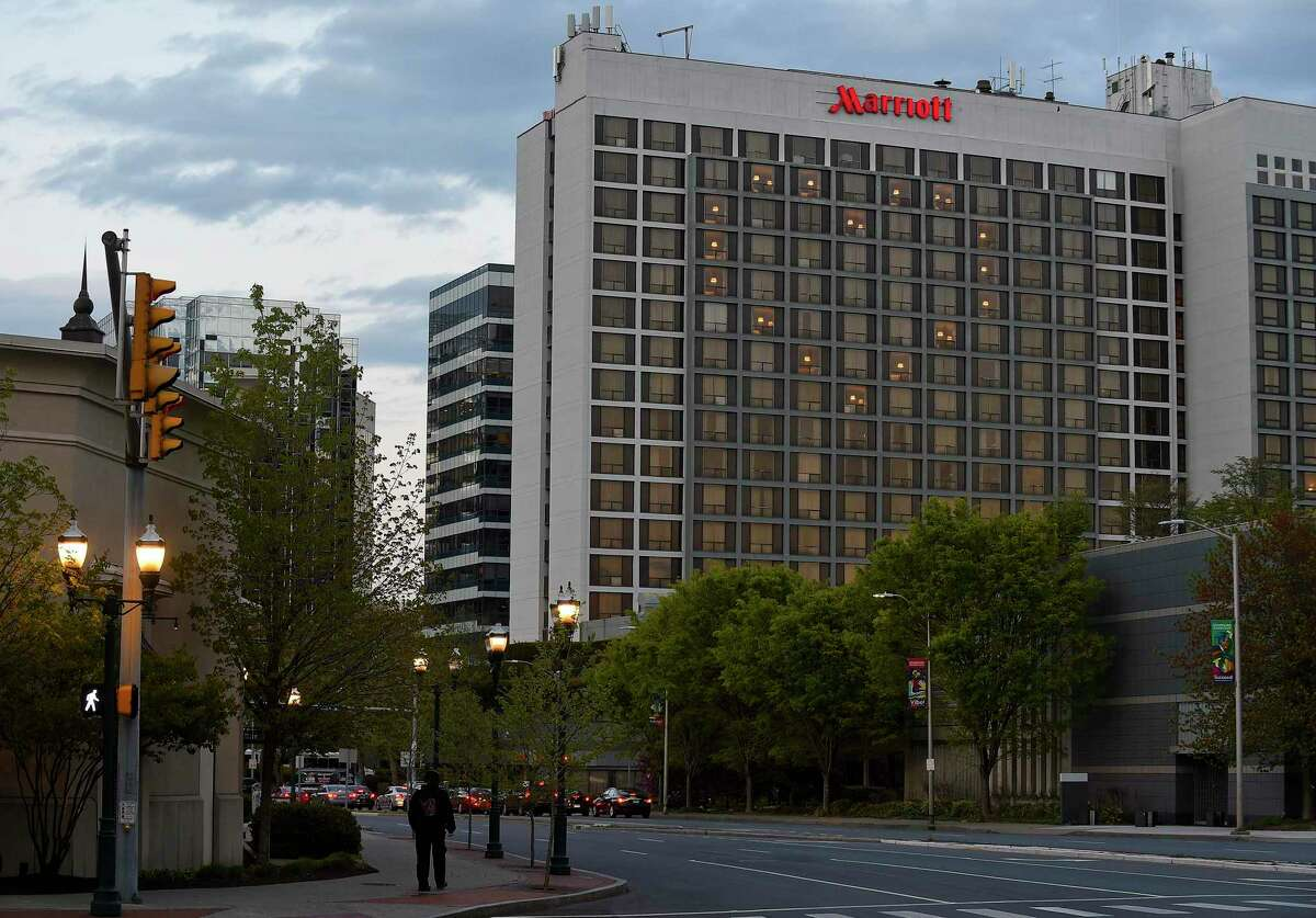 A 'Heart for Heroes' is illuminated in the windows of the Stamford Marriott on May 7, 2020 in Stamford, Conn. After the issue of protections for hospital and supermarket workers dominated attention in early May, an affiliate of the Unite Here union asked Gov. Ned Lamont to mandate safeguards for hotel industry workers when venues are allowed to resume normal bookings on June 20.