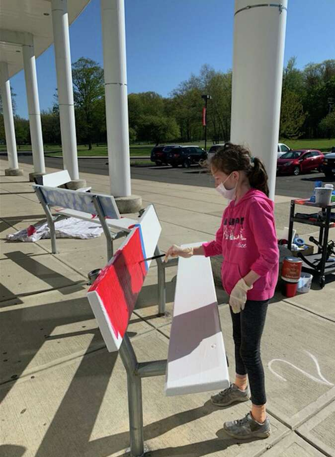 Saxe Middle School students paint benches as part of the The Saxe Spirit Bench club's project. Photo: New Canaan Public Schools