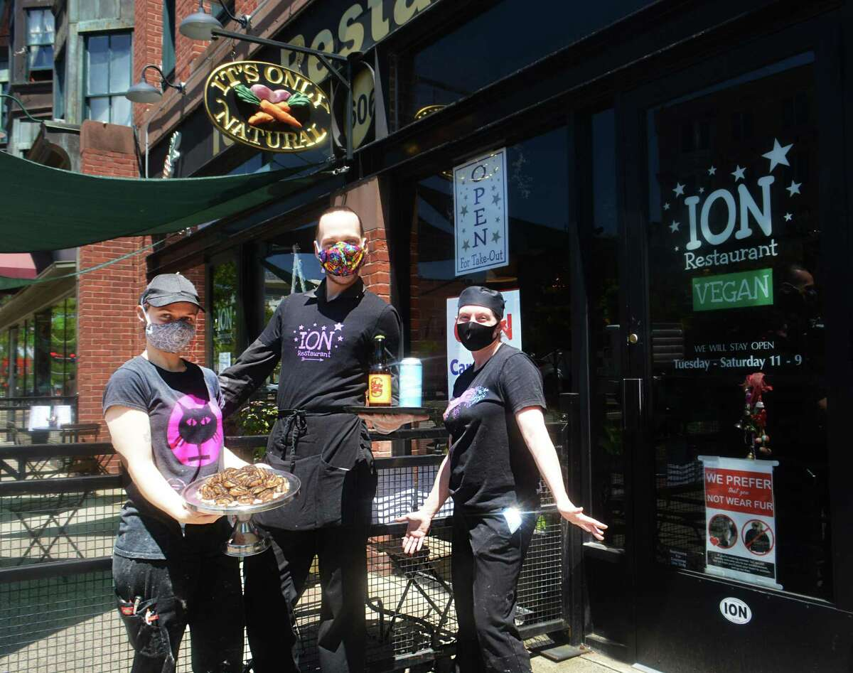 ION Restaurant on Main Street in Middletown opened its patio Wednesday to outdoor dining in accordance with guidelines set by the governor for outdoor dining during the coronavirus outbreak. From left are baker Grace Ouellette, manager Jared White and chef Amy Lovett.