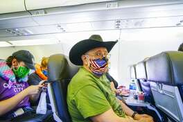 Masks are a must when it comes to air travel Pictured: Passengers at San Diego International Airport onboard an American Airlines flight to Charlotte, North Carolina,on May 20, 2020. This slideshow was first published on Stacker