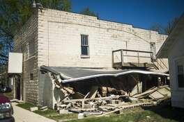 People survey the destruction in downtown Sanford Thursday afternoon. (Katy Kildee/kkildee@mdn.net)