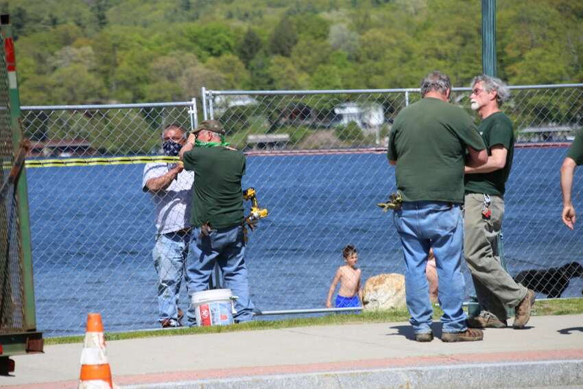 Dozens of people recreate on Dog Beach, state-owned land next to Million Dollar Beach, on Thursday in Lake George.