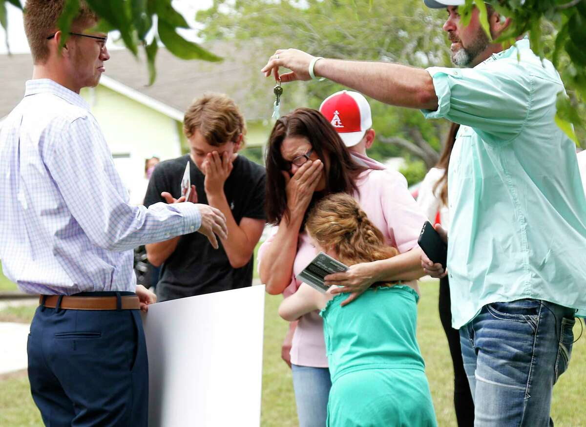 Members of the Ferguson family react as they find out they were also surprised with a new home by the Kailee Mills Foundation in Groesbeck, Texas on May 21, 2020.