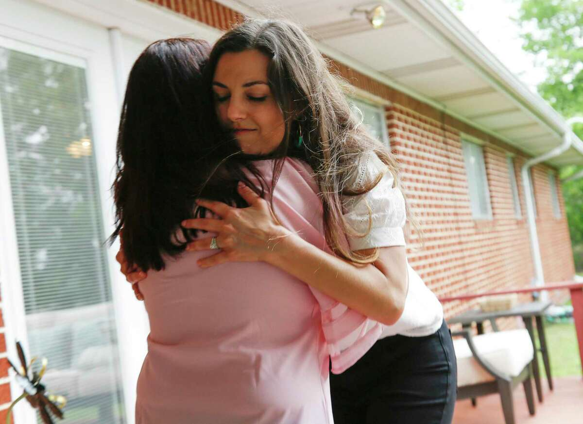 Briana McCulloch of the Kailee Mills Foundation hugs Judy Ferguson, after the foundation and others donated a home to Ferguson and her grandchildren so they can live together in Groesbeck, Texas on May 21, 2020.