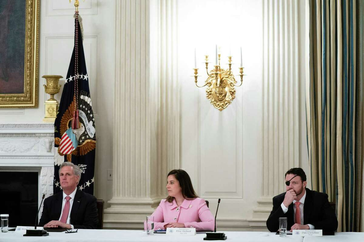"""WASHINGTON, DC - MAY 08: (L-R) House Minority Leader Kevin McCarthy (R-CA), Rep. Elise Stefanik (R-NY) and Rep. Dan Crenshaw (R-TX) attend a meeting with U.S. President Donald Trump and fellow Congressional Republicans in the State Dining Room at the White House May 08, 2020 in Washington, DC. Trump insisted that the national economy will recover this year from the damage caused by novel coronavirus pandemic, saying, """"I'm calling it the transition to greatness."""" (Photo by Anna Moneymaker-Pool/Getty Images)"""