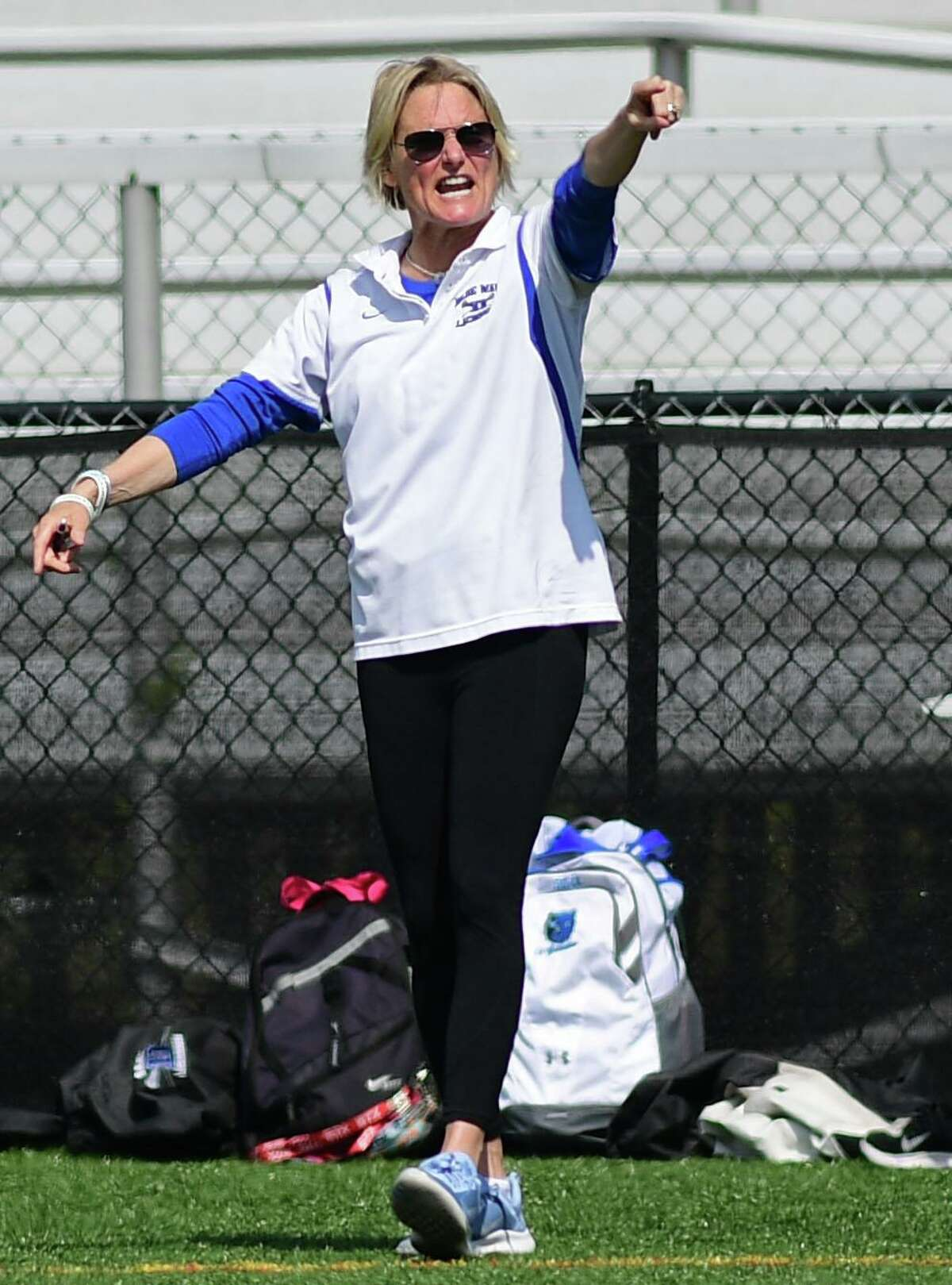 Blue Wave head coach Lisa Lindley talks to her players as The No. 1 Darien High School Blue Wave takes on the New Canaan Highh School Rams in their FCIAC girls lacrosse game Saturday. May 4, 2019, in New Canaan, Conn. New Canaan girls lacrosse team defeated the rival Darien Blue Wave 12-11 in the Class L semifinals last spring.