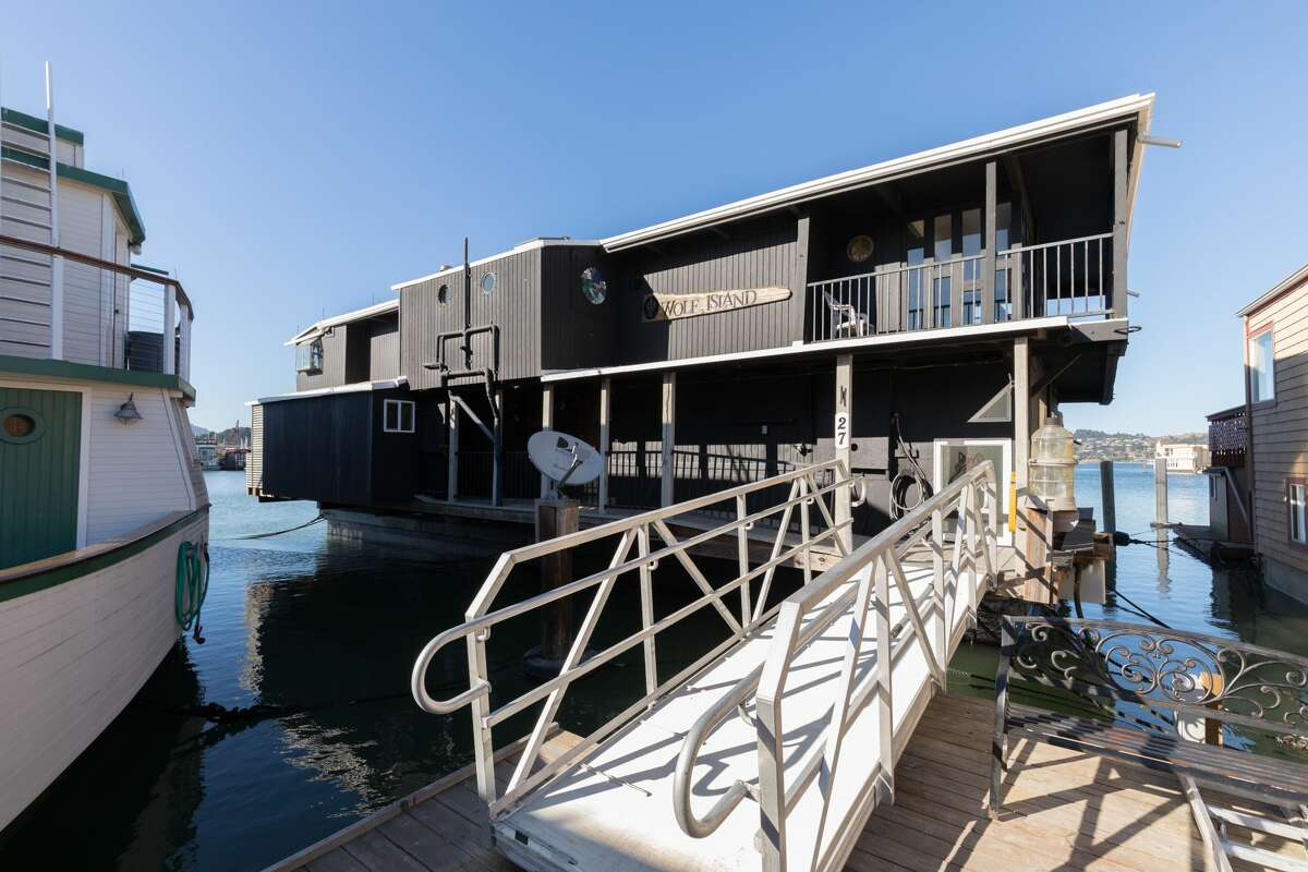 """The home has long been """"the heart of Main Dock, hosting seasonal gatherings and dock parties."""" The large floating dock berthed a 32' powerboat for 30 years that current owners used to transport family and friends directly from the back door up to the Sacramento Delta, listing agent Steve Sekhon told SFGATE."""