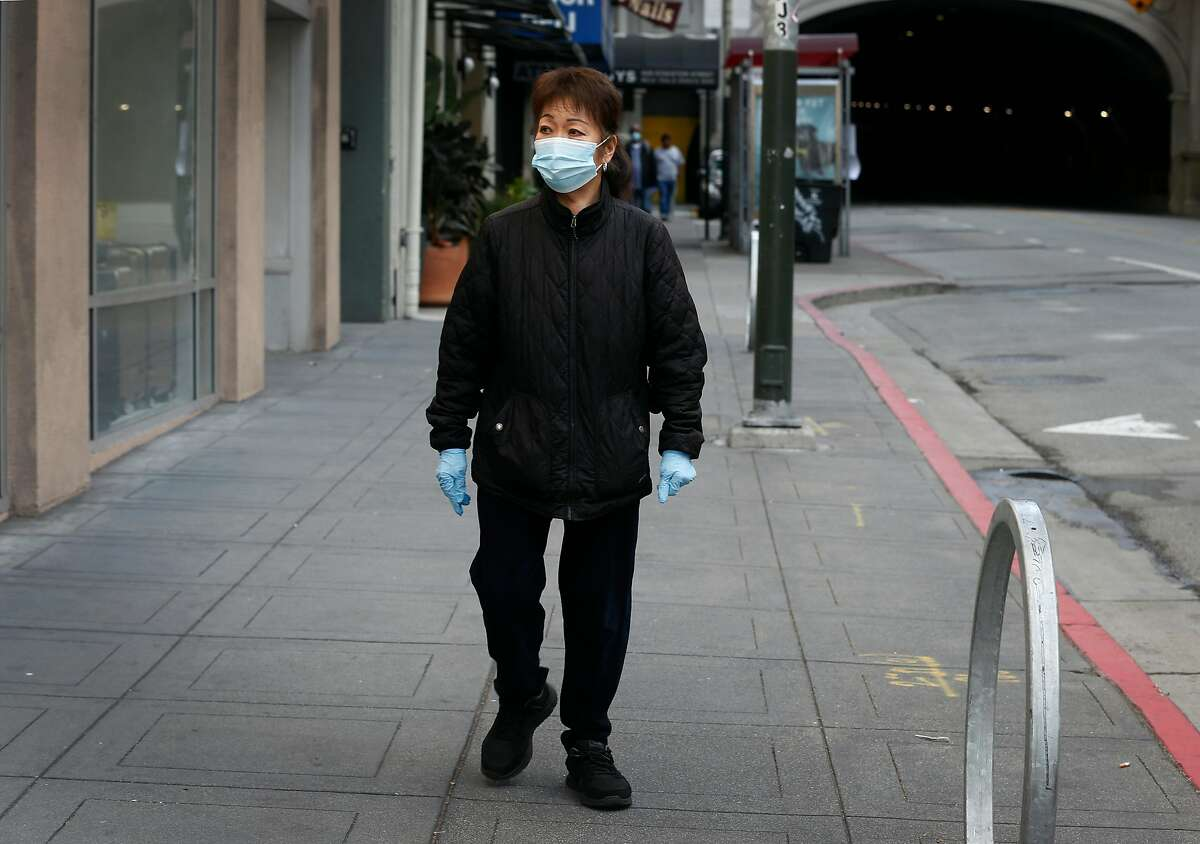 Mary Benedetto is seen in San Francisco, Calif. on Tuesday, May 19, 2020. Benedetto was laid off in April from her job cleaning United Airlines passenger clubs after the coronavirus pandemic crushed the air travel industry.