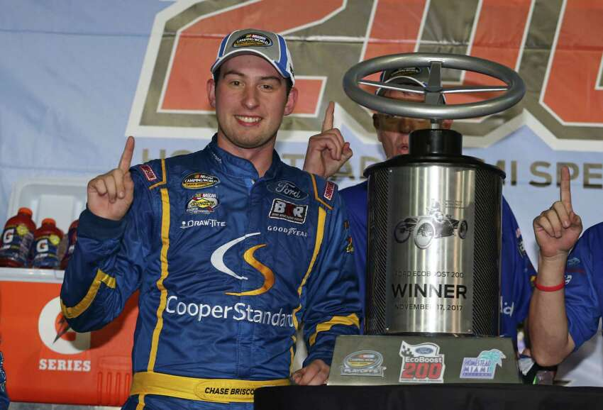 HOMESTEAD, FL - NOVEMBER 17: Chase Briscoe, driver of the #29 Cooper Standard Ford, celebrates in Victory Lane after winning the NASCAR Camping World Truck Series Championship Ford EcoBoost 200 at Homestead-Miami Speedway on November 17, 2017 in Homestead, Florida. (Photo by Matt Sullivan/Getty Images) ORG XMIT: 775075462
