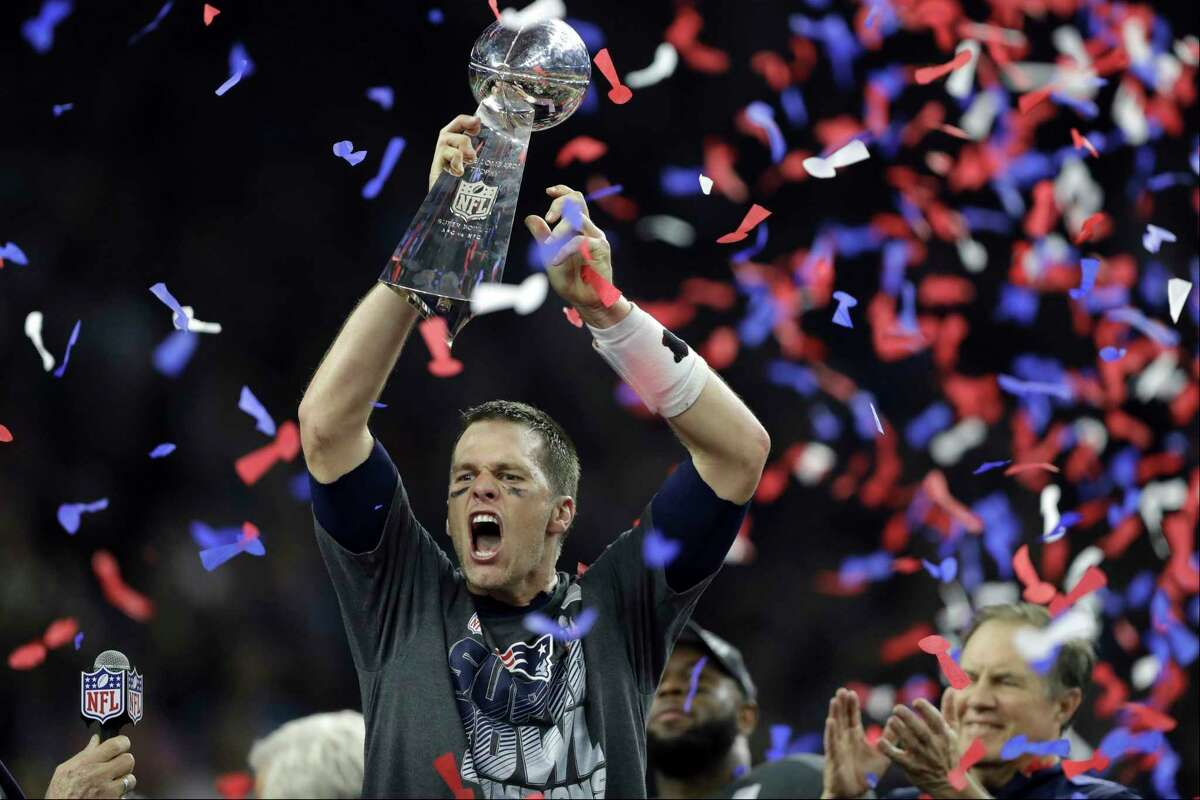 FILE - In this Feb. 5, 2017, file photo, New England Patriots' Tom Brady raises the Vince Lombardi Trophy after defeating the Atlanta Falcons in overtime at the NFL Super Bowl 51 football game in Houston. Bradya€™s journey to each of his nine Super Bowls with the New England Patriots will be the subject of an ESPN series released in 2021. Entitled a€œThe Man in the Arena: Tom Brady,a€ the nine-episode series will include a look from Bradya€™s perspective at the six NFL titles and three Super Bowl defeats he was a part of. (AP Photo/Darron Cummings, File)