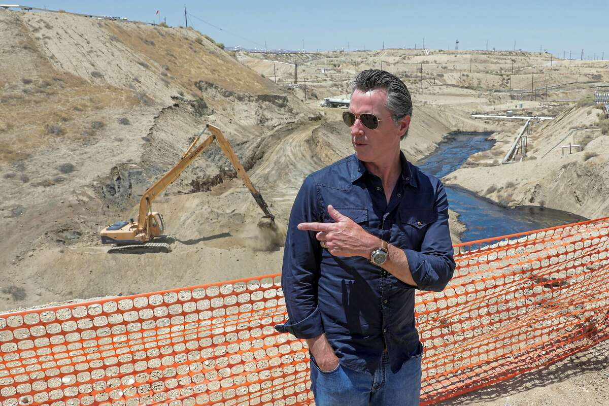 McKITTRICK, CA - JULY 24, 2019: Gov. Gavin Newsom tours the Chevron oil field west of Bakersfield where a spill of more than 900,000 gallons of oil and brine water oil has flowed into a dry creek bed July 24, 2019 near McKittrick, California. Newsom said the state needs to be more aggressive in regulating oil drilling to avoid other major spills. (Photo by Irfan Khan/Los Angeles Times via Getty Images)