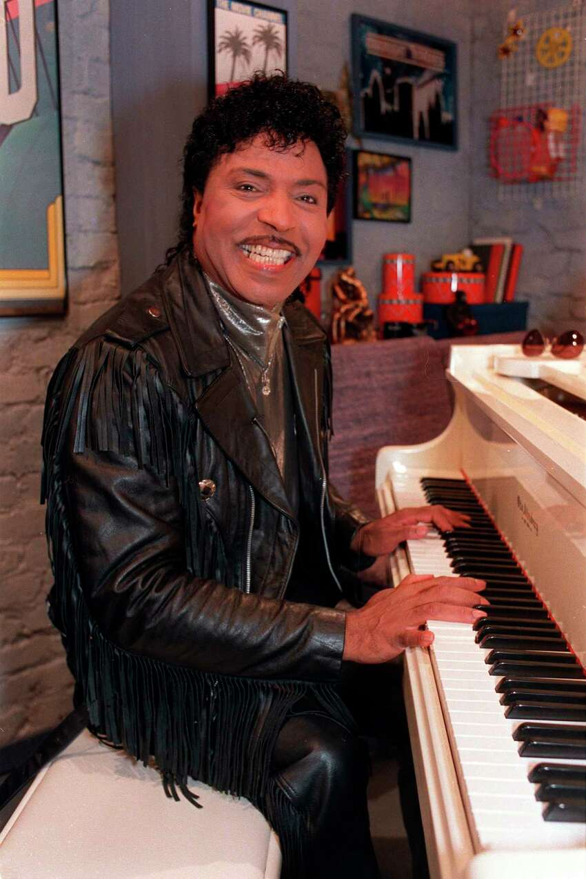FILE - In this Jan. 22, 1988 file photo, Little Richard plays the piano during taping at The Movie Channel Inc., in New York. Little Richard, the self-proclaimed a€œarchitect of rock a€˜na€™ rolla€ whose piercing wail, pounding piano and towering pompadour irrevocably altered popular music while introducing black R&B to white America, has died Saturday, May 9, 2020. (AP Photo/Mark Lennihan, File)