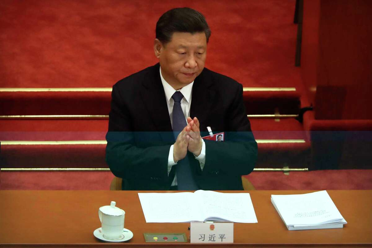 Chinese President Xi Jinping applauds during the opening session of China's National People's Congress (NPC) at the Great Hall of the People in Beijing, Friday, May 22, 2020. (AP Photo/Ng Han Guan, Pool)