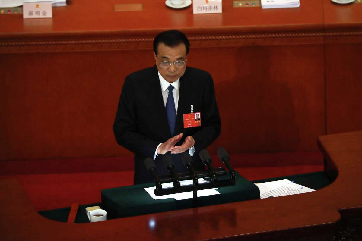 Chinese Premier Li Keqiang delivers the government work report during the opening session of China's National People's Congress (NPC) at the Great Hall of the People in Beijing, Friday, May 22, 2020. (AP Photo/Ng Han Guan, Pool)