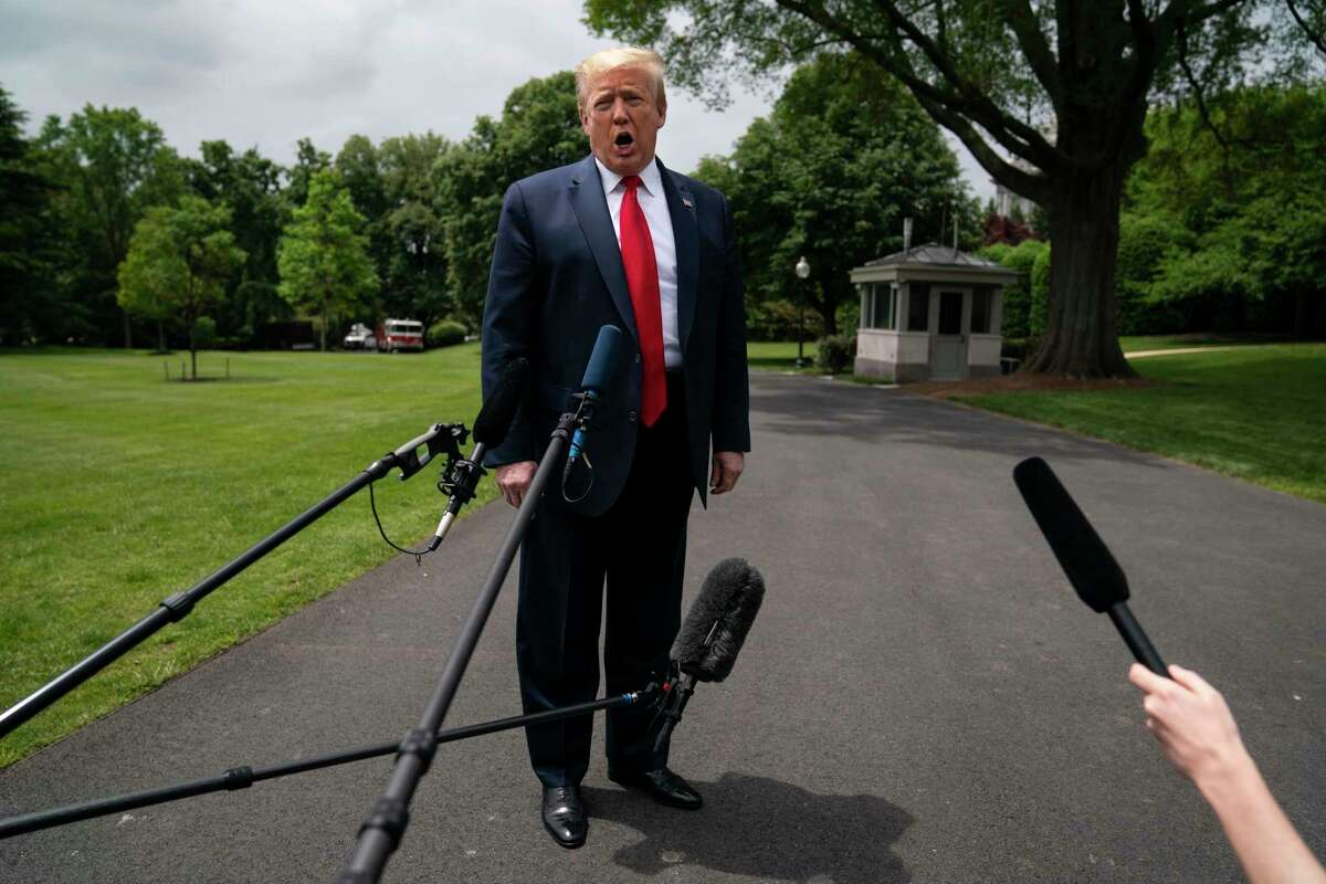 President Donald Trump talks to reporters before departing the White House for a trip to Michigan, Thursday, May 21, 2020, in Washington. (AP Photo/Evan Vucci)